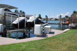 jetskis on boat lift | Naples Marine Construction - Naples, Florida