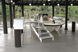 boat dock with boat house | Naples Marine Construction - Naples, Florida