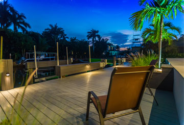 about us home block - two chairs on a Naples Marine Construction deck | Naples Marine Construction - Naples, Florida